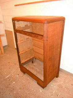 after complete stripping and a final sanding, english chestnut applied to the body of the dresser