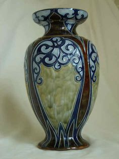 This is a stunning # pottery vase. The unique blend of colors, swirls and defining lines all contribute to its intrigue.