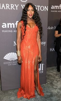 Naomi Campbell shined in an orange dress by Versace during the 19th Annual amfAR New York Gala.