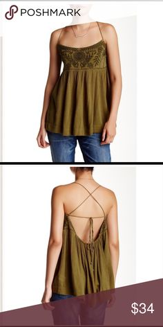 """Free People Blackbird Blouse New with tags. Olive green. Floral embroidery accents the bust with strappy shoulders and an empire waist. Open back with self tie strings. Length is approximately 24"""". Materials: 60% Rayon, 40% Cotton. ***NO TRADES*** Free People Tops"""