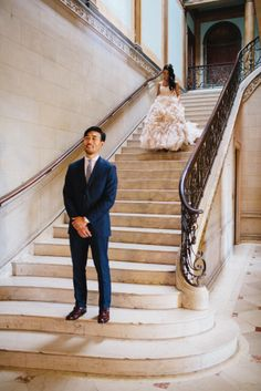 First look on the grand staircase at Jane & Jeff's Alder Manor Wedding | Sweet Little Photographs