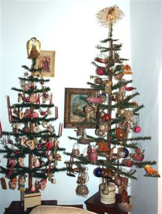 Antique feather trees with antique ornaments. Makes a lovely display together.