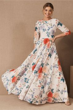 Vibrant florals and a breezy silhouette make this maxi dress the perfect pick for any warm weather celebration.