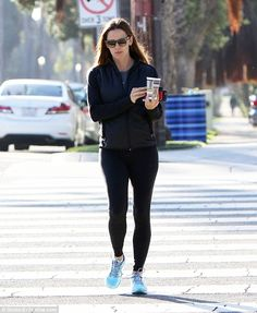 Daily grind: The 44-year-old actress enjoyed a gym session and then treated herself to a large coffee afterwards