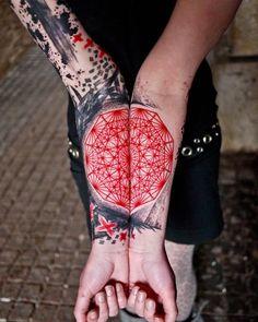 Black and red geometric sleeve tattoo