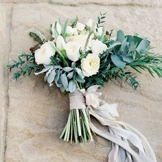 We are totally in love with this hand tied neutral bouquet  Have you chosen your wedding flowers yet?  Photo Credit // Wedding Sparrow  www.wed2b.co.uk/?fb
