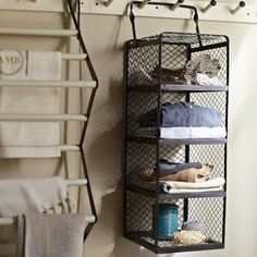 In the quest to stay organized, storage is king. Especially in the laundry room. Though organization and laundry rooms are a somewhat utilitarian and practical matter, there's no reason your storage solutions can't also enhance your decor. Simple wall-mounted shelves, cabinet units for baskets and bins, and laundry-specific accessories like fold-away ironing boards can make your washing and drying chores so much easier. Whether you choose to buy a furniture storage system, or build your own…