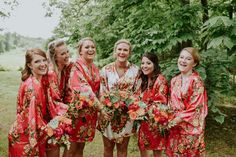 Bridesmaids getting ready robes | Punch colored, rustic chic summer barn wedding | The Barn at Twin Oaks Ranch | Andrea Clark Photography