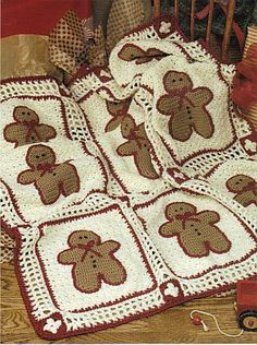 Gingerbread afghan ~ I think it would be more fun to make this from recycled felted sweaters (with maybe some crocheted borders / edges), and cut the Gingerbread People shapes out of felt too, appliqueing them onto the background squares