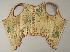 Stomacher: A stomacher is a filler for the front of a dress. It is often very elaborate and removable so it can be worn with different garments. This Italian century stomacher is located in the Metropolitan Museum of Art. It made of silk and linen. Vintage Corset, Vintage Underwear, Vintage Hats, Corsage, Italian Outfits, Italian Clothing, Antique Clothing, 18th Century Stays, Historical Clothing