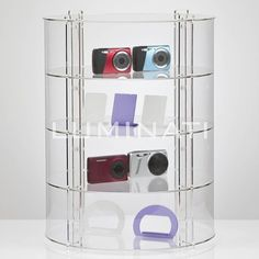 Circular display cabinet made from acrylic, shelves with optional locking door.  Great for a retail environment. Designed and manufactured in the UK.