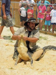 "The ""Gator Boys"" came to the Gulf Coast Gator Ranch this summer. The two operate Gator Boys Alligator Rescue, capturing nuisance alligators with their bare hands and moving them to safety before the trappers arrive who kill the animals for their meat and skin."