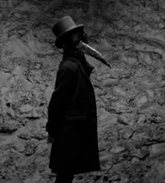 """Plague doctors were employed in various methods whenever plague set in. The earliest documentation of these individuals being hired go as far back as the mid 500s AD. The plague doctor image that we as a general public are familiar with was not seen until the 1600s. It was then that the """"traditional"""" plague doctor costume was created. The costume consisted of a cloak made of heavy fabric covered in wax to protect the doctor's body, and a mask to keep out the sick air."""