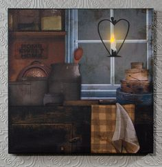 Country window lighted picture.  the candle flame lights up and flickers like a real candle.  There are over 300 designs available and they make great Christmas gifts. Shelley B Home and Holiday