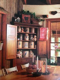 Primitive Corner Cupboard...filled with old salt glazed crocks.
