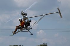 "Mosquito ultralight helicopter flying ""down on the farm"" at AirVenture 2012, via flickr user Boarder2."