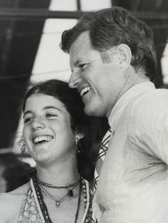 YOUNG KENNEDY – New York: Caroline Kennedy, daughter of the late President John F. Kennedy and Jacqueline Kennedy Onassis, chats with her Uncle, Senator Edward Kennedy (D-Mass.) at the Robert F. Kennedy pro-celebrity Tennis Tournament at Forest Hills August 28th. The affair is an annual charity get-together. 8-31-75