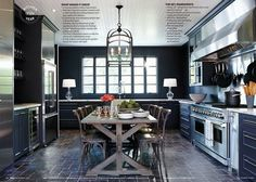 Double ovens in a beautiful kitchen. Obsessed with the table, although I'd probably replace it with an island