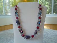 Fushia beads with purple iridescent and fushia crystals.