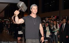 Chris Hemsworth holds up the hammer of Thor at Tokyo airport | Mail Online