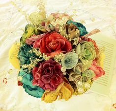a bouquet at a friend of a friends wedding. (each flower was a book or map, each one had a special meaning to the couple and their relationship.) in LOVE with it.