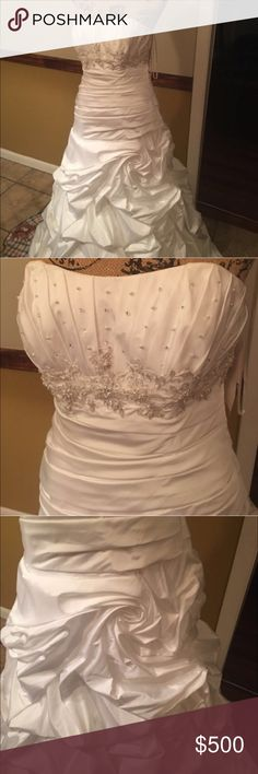 NWT David bridal wedding gown Dress a size 10. Wedding dresses run small so 10 is a size 8. Dress has beaded bust featured in pic 3. Dress has swirl design on the skirt featured in pic 4. Dress is brand new with tags has not been worn and has not been altered David's Bridal Dresses Wedding