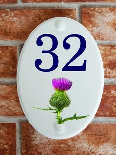 A range of pottery style house plaques feature prints of original artwork from our own sign artists. Hand cast in cultured marble these number plates are weatherproof outdoors. House Plaques, House Number Plaque, House Numbers, Scottish Thistle, Floral Motif, Decorative Plates, Pottery, Signs, Home Decor