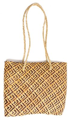 Handwoven Flax Maori Kete  Flax, natural dye pigment Handmade in New Zealand Size 35cm width, 29cm length, 7cm depth, handle  36cm length. From the Gather Shop.