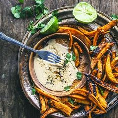 Roasted sweet potatoes with garlic and lime tahini