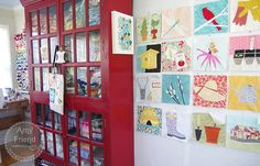 Love this colored cabinet & wall art made from quilt blocks on During Quiet Time.  This creative space is a must see.