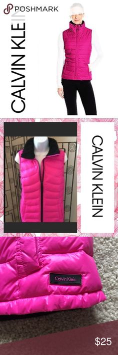 Calvin Klein pink puffer vest Calvin Klein pink puffer vest, wonder resistant, MP3 pocket, size medium only worn once Calvin Klein Jackets & Coats Puffers