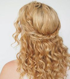 Flaunt your natural curls with this simple half-up, half-down curly prom hairstyle. You don't even have to know how to braid. Just grab a few pins, and Hair Romance will walk you through the rest of the steps.