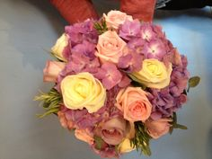 Hydrangea, avalanche, memory lane and sweet dolomiti roses make this full hand tied bridal post. A x