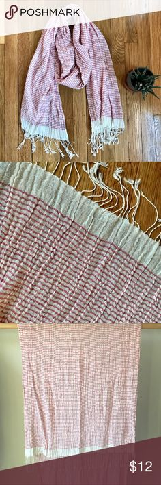 """NWOT Boho Summer Scarf Adorable NWOT scarf with salmon and cream mini-stripes, and fun playful fringe on both ends. Fabric is a beautiful gauzy texture, with boho crinkly pleats. Works great as an accessory for business casual, and just as well on the beach as a cover up or shawl. Versatile and cute! Open to all offers... and I usually say """"yes!"""" Thanks for visiting my closet and happy poshing! Accessories Scarves & Wraps"""