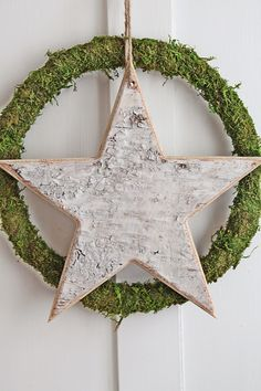 Bark star on moss wreath. Simple Christmas decor, so beautiful