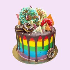 A rainbow cake is fun to look at and eat and a lot easier to make than you might think. Here's a step-by-step guide for how to make a rainbow birthday cake. Rainbow Frosting, Rainbow Cakes, Crazy Wedding Cakes, Mini Tortillas, Baked Doughnuts, Chocolate Drip, Gateaux Cake, Cake Online, Rainbow Birthday