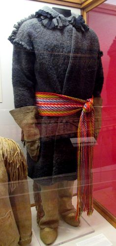 """1888-1889 Outfit worn by Charles Trick Currelly at the Royal Ontario Museum, Toronto - From the curators' comments: """"It consists of a capote made from a Hudson Bay three-point blanket, a woven sash and beaded skin jacket, leggings, moccasins and gauntlets. The capote, originally white with coloured bands was dyed black by Dr. Currelly's mother who considered the bright colours unsuitable for a Methodist missionary."""""""