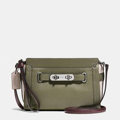 "55914 Dark Gunmetal/Surplus Multi Coach Swagger Wristlet in Colorblock Leather Calf leather Inside open pocket Zip-top closure, fabric lining Strap with clip to form a wrist strap or small top handle Strap with 22"" drop for crossbody wear 8"" (L) x 5 1/2"" (H) x 2"" (W)"