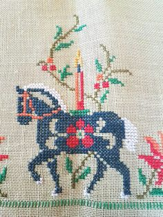 Beautiful christmas cross stitch embroidered tablecloth/table cover in green light linen, mint condition. Crispy never used. The size is: 32 x 32 The material is linen, cottonthread,. Iallso offer combined shipping and refund if the shipping cost is overpaid. Contact me if you have