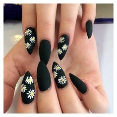 Beautiful black matte nails with white flowers ❤ liked on Polyvore featuring beauty products and nail care
