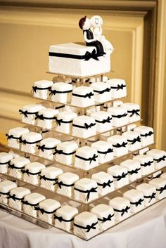 Wedding Food Fancier than cupcakes but more portable than cake, these mini cakes are the perfect compromise. - Cakes and cupcakes aren't the only desserts that can be served in tiers! Get inspired by these fun ideas Fancy Wedding Cakes, Wedding Cakes With Cupcakes, Wedding Cake Designs, Wedding Desserts, Wedding Cake Toppers, Cupcake Cakes, Wedding Decorations, Mini Cakes, Cup Cakes