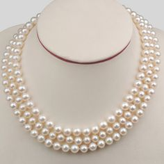 Triple strand pearl necklace...Simple but elegant...