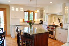 Add a couple glass front cabinet doors.  White Upper Cabinets Design Ideas, Pictures, Remodel, and Decor - page 59