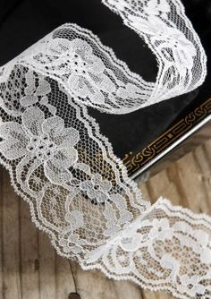 9.99 SALE PRICE! This dainty, delicate lace ribbon is a lovely and versatile decoration. Use the Lace Ribbon in White to fashion fancy bows to adorn an exqui...