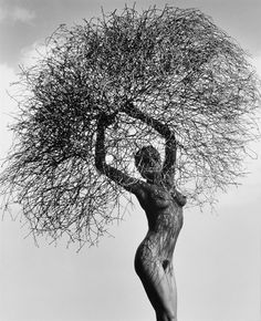 Neith with Tumbleweed, Paradise Cove by Herb Ritts