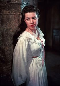 Valerie Gaunt as Justine in THE CURSE OF FRANKENSTEIN (1957) prepares to search Victor Frankenstein's (Peter Cushing) laboratory, and come face to face with Christopher Lee's Creature.
