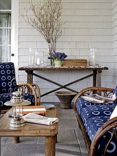 The white and blue fabric is a nice change from blue and white stripes for porch furniture.