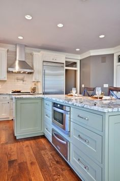 """Layout for fridge and cooktop, island idea with """"kick-out""""  Also, Transom windows over doors"""