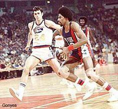 Bobby Jones (Denver Nuggets) and Julius Erving
