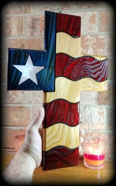 American flag wood wall cross with stained glass star Wooden Crosses, Wooden Flag, Wall Crosses, Stain Glass Cross, Cross Wall Decor, American Flag Wood, Cross Crafts, Wood Art, Wall Wood